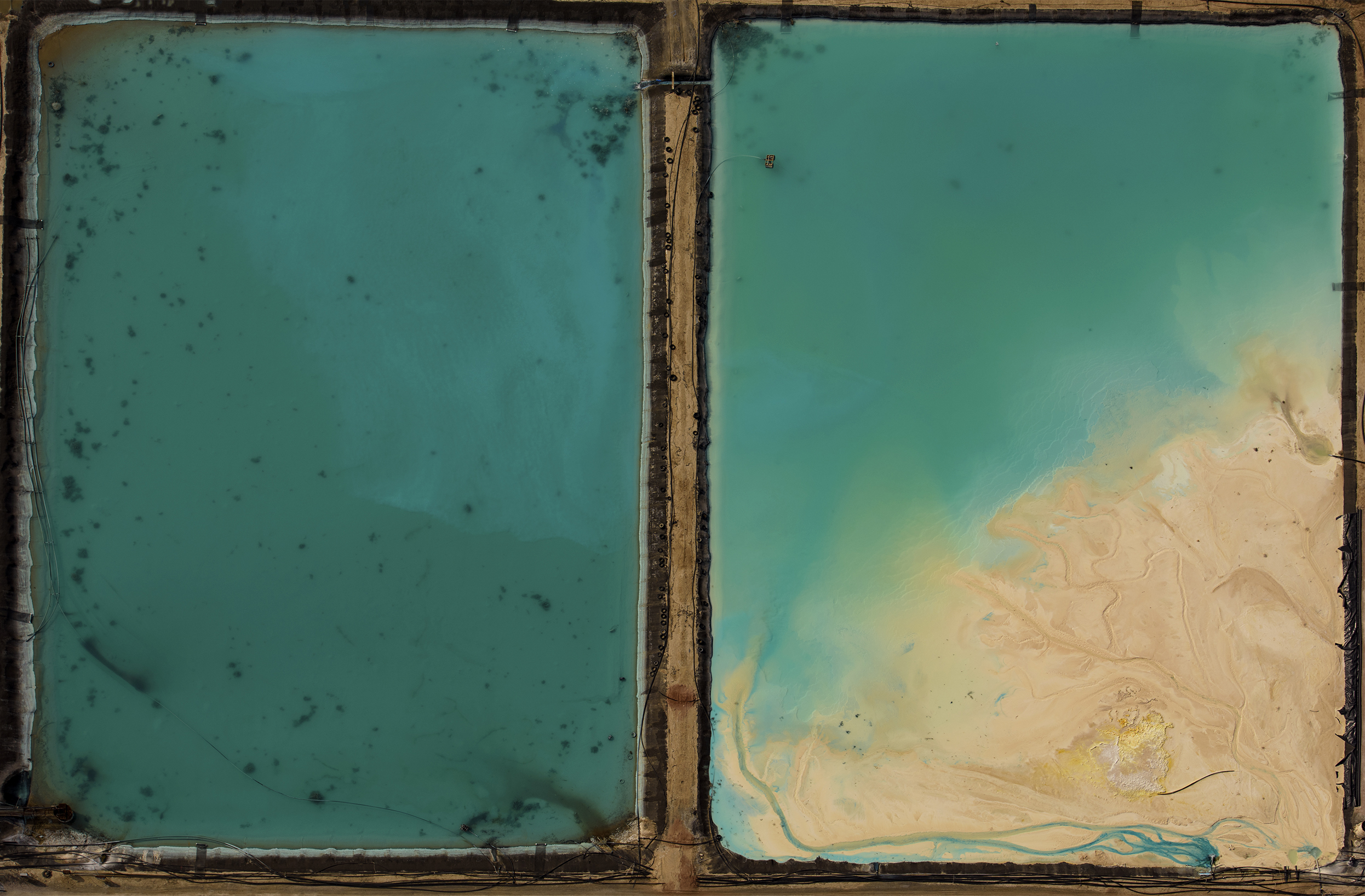 Industrial ponds, property of Waste Management, Inc., New Mexico. Aerial image (shot from a plane at 1,000 feet).